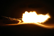 Golan Heights, Israel, Israeli Merkava tank firing a shell during night practice