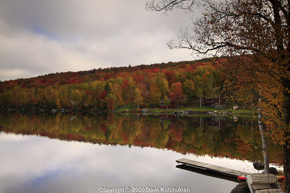 FALL AT PEACHAM POND, PEACHAM, VT.  CALM WATERS CREATE MANY VIVID REFLECTIONS
