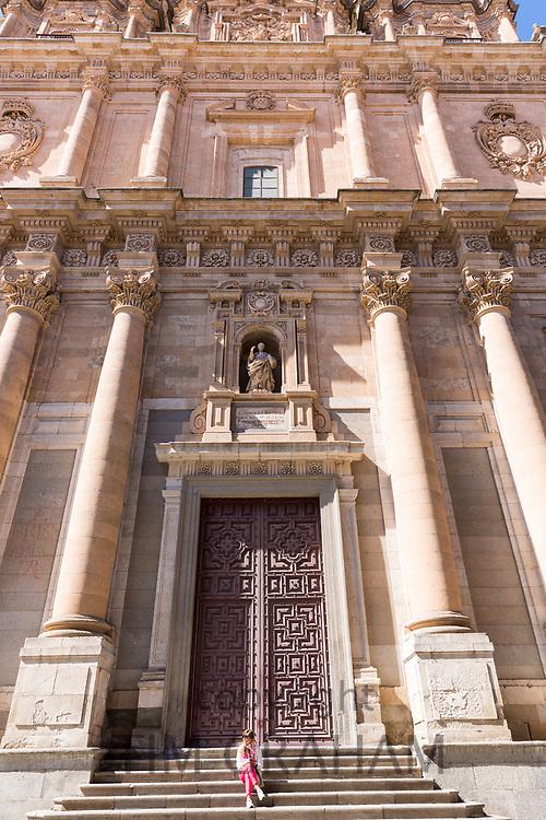 Woman on steps of University of Salamanca, Universidad Pontifical, (Pontifical) Roman Catholic University, Spain