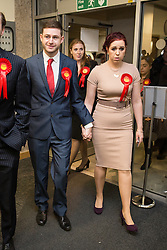 © Licensed to London News Pictures . 04/12/2015 . Oldham , UK . Labour candidate JIM McMAHON arrives with his wife CHARLENE . The count at the Oldham West and Royton by-election , at the Queen Elizabeth Hall in Oldham . The by-election was called following the death of MP Michael Meacher . Photo credit : Joel Goodman/LNP