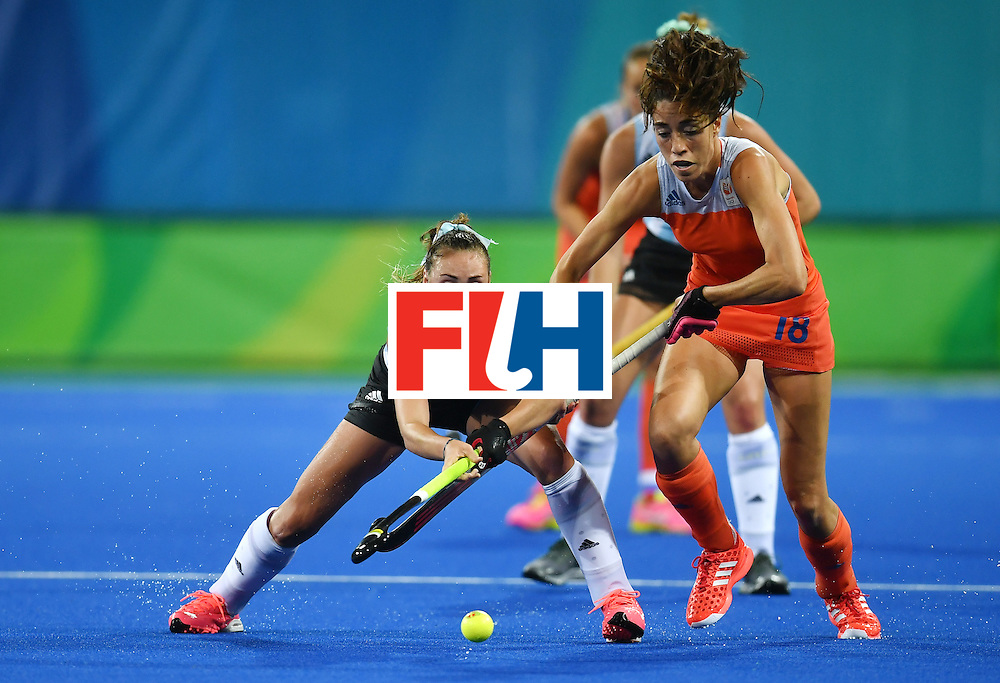 Argentina's Florencia Habif (L) vies with Netherland's Naomi van As during the women's quarterfinal field hockey Netherlands vs Argentina match of the Rio 2016 Olympics Games at the Olympic Hockey Centre in Rio de Janeiro on August 15, 2016.  / AFP / MANAN VATSYAYANA        (Photo credit should read MANAN VATSYAYANA/AFP/Getty Images)