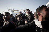 ITALY. Lampedusa:Tunisian migrants arrive in Lampedusa  on March  27, 2011. Copyright Christian Minelli.