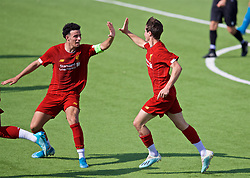 NAPLES, ITALY - Tuesday, September 17, 2019: Liverpool's substitute Layton Stewart (R) celebrates scoring the equalising goal, with team-mate captain Curtis Jones, to level the score 1-1 during the UEFA Youth League Group E match between SSC Napoli and Liverpool FC at Stadio Comunale di Frattamaggiore. The game ended in a 1-1 draw. (Pic by David Rawcliffe/Propaganda)