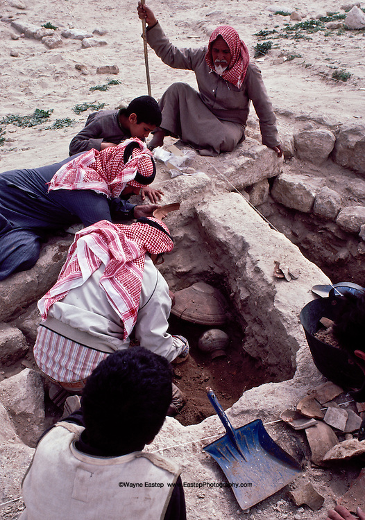 Local residents overlook discovery of a pot and camel fragment, Thaj, Saudi Arabia