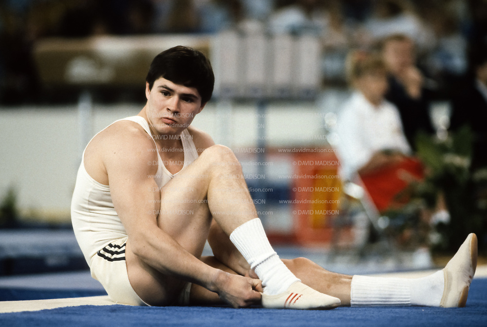 PHOENIX - APRIL 24:  Dimitri Belozerchev of the USSR prepares to compete in the floor exercise during a USA - USSR gymnastics meet on April 24, 1988  at the Arizona Veterans Memorial Coliseum in Phoenix, Arizona.  (Photo by David Madison/Getty Images)