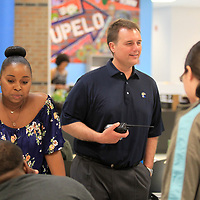Jason Harris, Principal at Tupelo High School, right, meets with Joan Perk Kelsie, the Help Desk Coordinator, as the students drop off their computers for the end of the year. Harris will finish his last school year as principal at Tupelo High School before moving to the Columbia School District as superintendent.