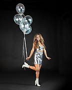 Fashion model, Brenna Smith with silver party balloons. By Gerard Harrison. Image Theory Photoworks