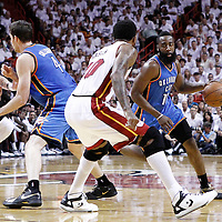 21 June 2012: Oklahoma City Thunder guard James Harden (13) drives past Miami Heat power forward Udonis Haslem (40) during the Miami Heat 121-106 victory over the Oklahoma City Thunder, in Game 5 of the 2012 NBA Finals, at the AmericanAirlinesArena, Miami, Florida, USA. The Miami Heat wins the series 4-1.