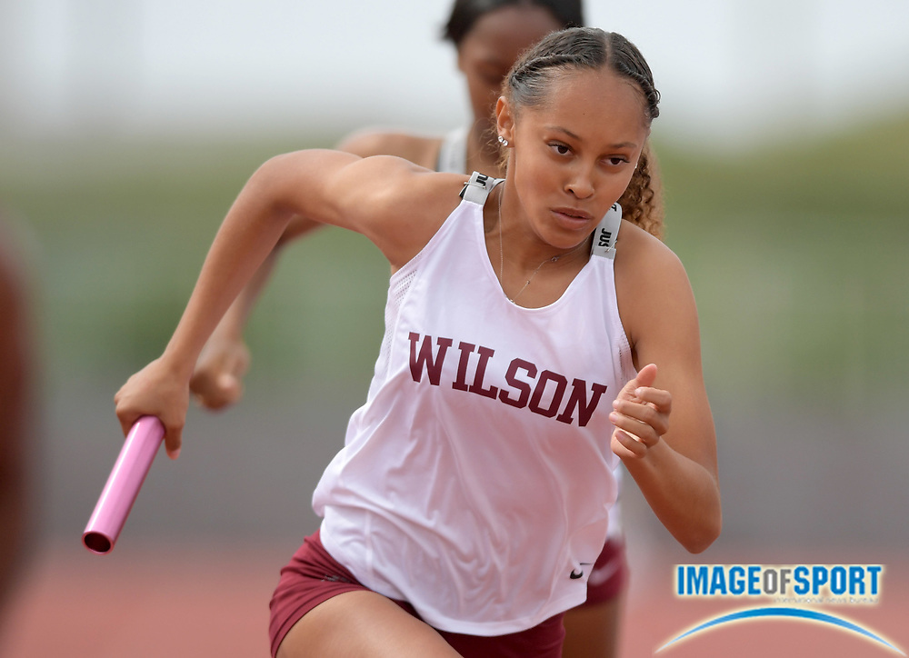 Maya Bryson runs the second leg on the Long Beach Wilson girls 4 x 400m relay that placed fourth in 3:45.98 during the 2019 CIF Southern Section Masters Meet in Torrance, Calif., Saturday, May 18, 2019.