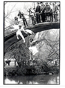 Greg Supra and Dotty Smith, Jumping into the river. May morning Oxford.1 May 1983. Party partly organised by Ding Boston, Film 83234f17<br />