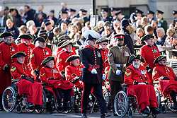 © Licensed to London News Pictures. 13/11/2016. London, UK.  Chelsea pensioners arrive before a Remembrance Day Ceremony at the Cenotaph war memorial in London, United Kingdom, on November 13, 2016 . Thousands of people honour the war dead by gathering at the iconic memorial to lay wreaths and observe two minutes silence. Photo credit: Ben Cawthra/LNP
