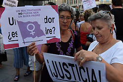 August 17, 2017 - Madrid, Madrid, Spain - Two women hold banners as they take part in a protest in Madrid against gender violence and to show support Juana Rivas. (Credit Image: © Jorge Sanz/Pacific Press via ZUMA Wire)