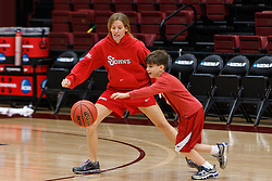 March 18, 2011; Stanford, CA, USA; St. John's Red Storm head coach Kim Barnes Arico plays basketball with her son during practice the day before the first round of the 2011 NCAA women's basketball tournament at Maples Pavilion.