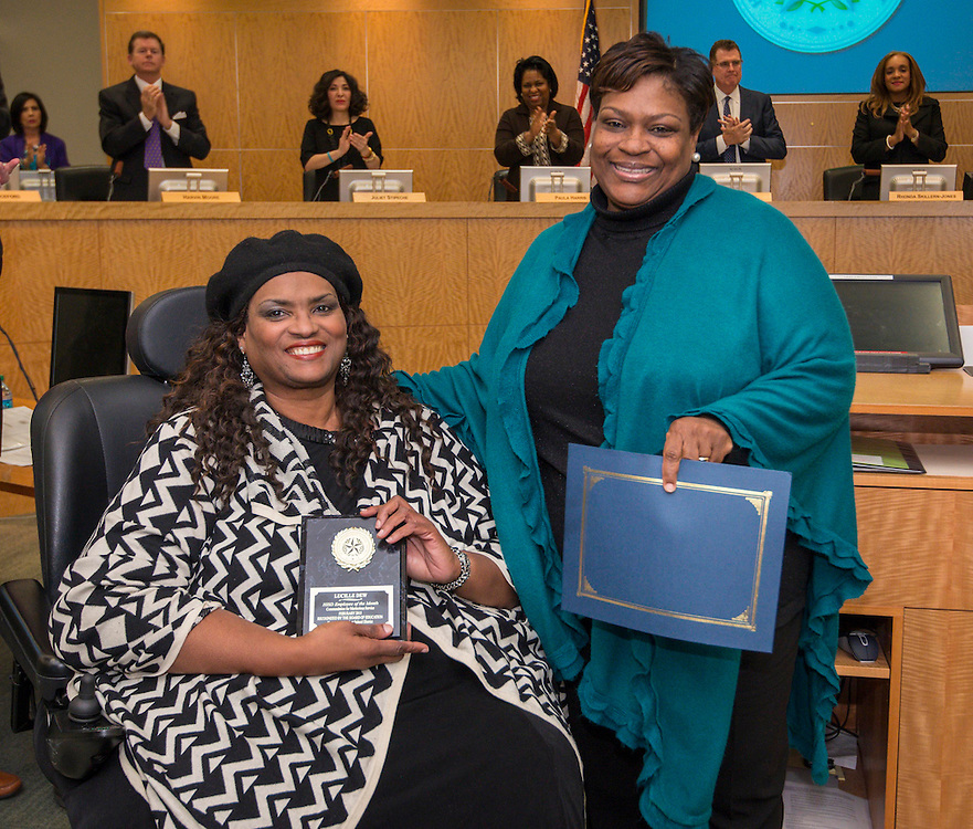 Lucille Dew, left, receives the Employee of the Month awards from North Early College High School principal Angela Lundy-Jackson, right, during the Houston ISD Board of Trustees meeting, January 15, 2015.