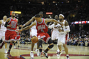 Apr 19, 2010; Cleveland, OH, USA; Cleveland Cavaliers forward Antawn Jamison (4) and guard Mo Williams (2) manage to knock the ball loose from Chicago Bulls guard Derrick Rose (1) during the third period in game two in the first round of the 2010 NBA playoffs at Quicken Loans Arena. The Cavaliers beat the Bulls 112-102. Mandatory Credit: Jason Miller-US PRESSWIRE