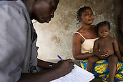 "A man trained as a ""basic community service agent"" (ASBC in French, for Agent Service de Base Communautaire) uses a standard form to diagnose a sick child in the village of Lalo, Benin on Friday September 14, 2007. ASBCs provide basic health diagnosis and treatment for patients in rural areas who can't readily access health centers."