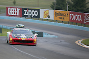 "Ricardo Perez drives his #2 car through ""the esses"" during a practice session at the Ferrari Challenge North America in Watkins Glen, New York, USA, on Saturday, September 20, 2014. Photographer: Mike Bradley/Bloomberg"