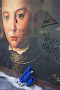 A reproduction of the painting called 'Portrait of Francesco I de' Medici ' which was painted by Agnolo de Cosimo Bronzino in 1551, now adorns a construction hoarding screen, with plastic blue piping in a Florence side street, the original hanging in the Uffizi. Born in Florence, he was the son of Cosimo I de' Medici, Grand Duke of Tuscany and Eleonora di Toledo, and served as regent for his father starting in 1564. He went on to become grand Duke of Tuscany and marry his Venetian mistress, Bianca Cappello, after aptly disposing of her husband, a Florentine bureaucrat. Francesco and Bianca died on the same day. Although the original death certificates mention malaria, it has been widely speculated that the couple was poisoned.