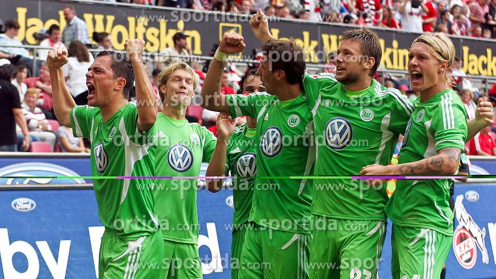 06.08.2011,  Rhein Energie Stadion, Koeln, GER, 1.FBL, 1. FC Koeln vs Vfl Wolfsburg, im Bild.Torjubel / Jubel  nach dem 0:2 durch Marcel Schäfer / Schaefer (Wolfsburg #4) (L) ..// during the 1.FBL, 1. FC Koeln vs Vfl Wolfsburg on 2011/08/06, Rhein-Energie Stadion, Köln, Germany. EXPA Pictures © 2011, PhotoCredit: EXPA/ nph/  Mueller *** Local Caption ***       ****** out of GER / CRO  / BEL ******