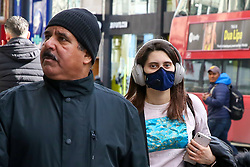 © Licensed to London News Pictures. 16/03/2020. London, UK. A woman wearing a face mask on Oxford Street, amid an increased number of Coronavirus (COVID-19) cases in the UK. 35 coronavirus victims have died and 1,372 have tested positive forthe virusin the UK as of9amon Sunday, 15 March 2020. Photo credit: Dinendra Haria/LNP