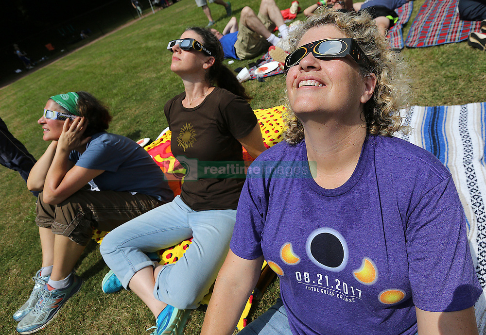 August 21, 2017 - Clayton, Georgia, U.S. - ROBYN DIAMOND (from left), SAM DRESSLER, and SHERIE GREEN, from Dunwoody, take in the total eclipse during a solar eclipse shabbat at Ramah Darom on Monday in Clayton, a city in the path of totality in North Georgia. (Credit Image: © Curtis Compton/TNS via ZUMA Wire)