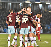 the Burnley team mnob Burnley Midfielder, Scott Arfield after his opener during the Sky Bet Championship match between Burnley and Charlton Athletic at Turf Moor, Burnley, England on 19 December 2015. Photo by Mark Pollitt.