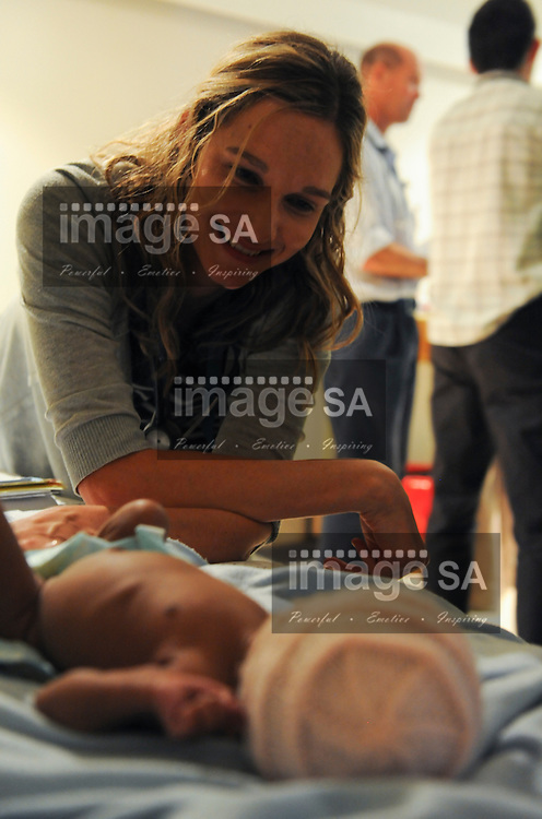 GEORGE, South Africa: Friday 16 November 2012,  Dr Martie Wege holds the foot of tiny Julimay September (born at 33 weeks) during the first South African Red Cross Air Mercy Service cardiology outreach programme to the Provincial Department of Health's George Regional Hospital. The aim of the outreach programme is to provide tertiary cardiology expertise at regional hospital level. Portable echocardiography is used to assist with patient assessment. The purpose of the outreach programme is to avoid patients and parents traveling a great distance to Cape Town's Red Cross war Memorial Children's Hospital for consultation with cardiology medical experts..Photo by Roger Sedres