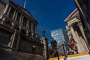 Bank of England on the left and neo-classical architecture of Cornhill Exchange, City of London.