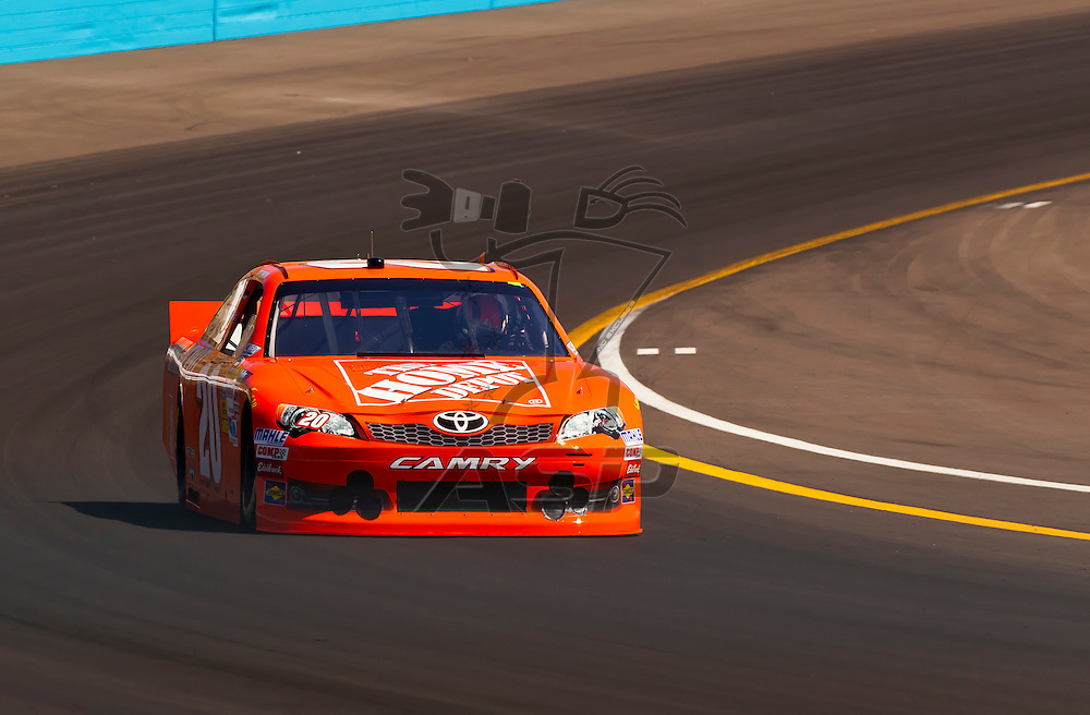 AVONDALE, AZ - MAR 03, 2012:  Joey Logano (20) brings his NASCAR Sprint Cup car through turn 4 during qualifying for the Subway Fresh Fit 500 race at the Phoenix International Raceway in Avondale, AZ.