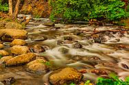 Water flows over rocks in McHugh Creek, summer, afternoon