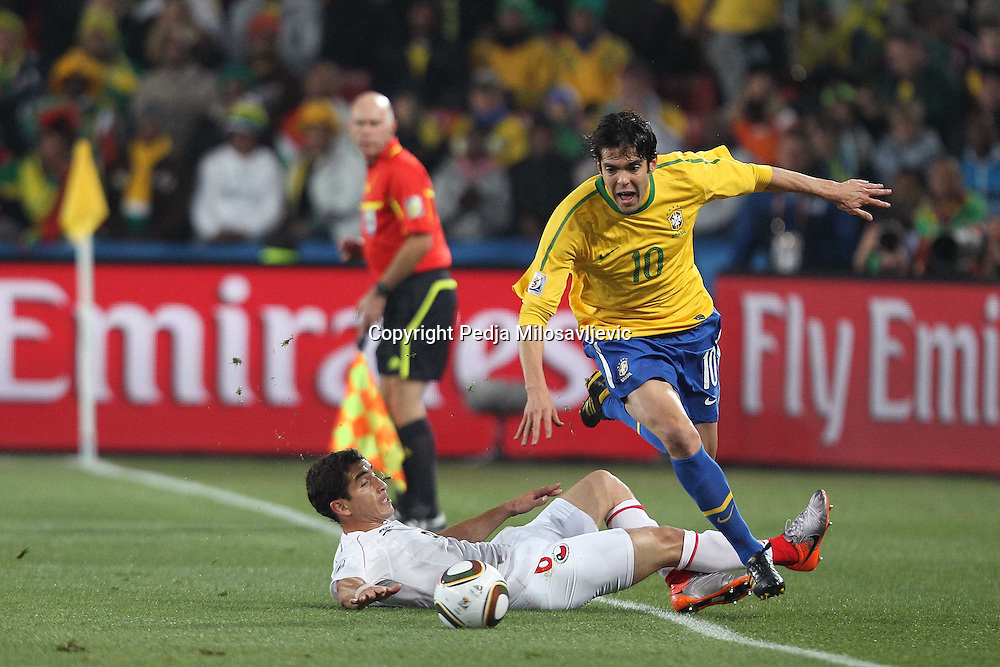 &copy;Jonathan Moscrop - LaPresse<br /> 28 06 2010 Johannesburg ( Sud Africa )<br /> Sport Calcio<br /> Brasile vs Cile - Mondiali di calcio Sud Africa 2010 Ottavi di finale - Ellis Park Stadium<br /> Nella foto: Kaka<br /> <br /> &copy;Jonathan Moscrop - LaPresse<br /> 28 06 2010 Johannesburg ( South Africa )<br /> Sport Soccer<br /> Brazil versus Chile - FIFA 2010 World Cup South Africa Round of sixteen  - Ellis Park Stadium<br /> In the Photo: Kaka hurdles his opponent on his way to goal