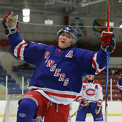 TORONTO, ON - OCT 19:  Keegan Blasby #17 of the North York Rangers, celebrates after scoring the game winning goal, during the OJHL regular season game between the Toronto Junior Canadiens  and North York Rangers. on October 19, 2016 in Toronto, Ontario. (Photo by Anna Matthews / OJHL Images)