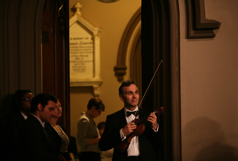 Gil Shaham, violinist, watches the choir while waiting to perform during Remember to Love: Let Us Love One Another With A Sincere Heart, an observation of the 10th Anniversary of September 11 at Trinity Church in Manhattan, NY on September 09, 2011. The six choirs performing include NYC Master Chorale, Trinity Choir, Young People's Chorus of New York City, The Washington Chorus, The Bach Choir of Bethlehem and The Copley Singers.