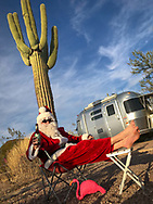 Santa Claus relaxes at a campsite in Organ Pipe Cactus National Monument, Arizona.