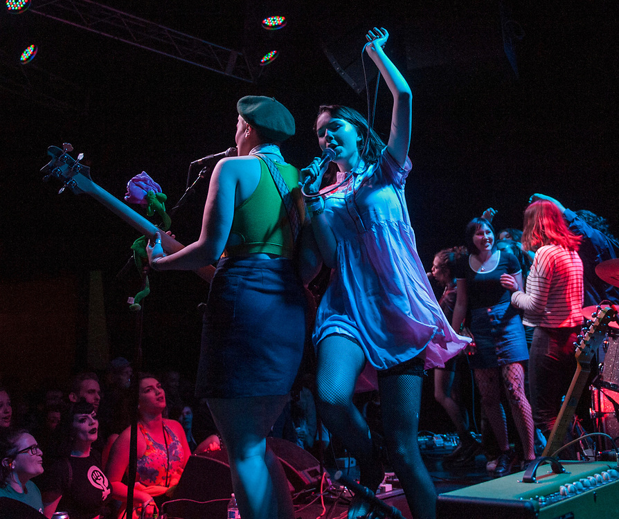 The Regrettes' Sage Nicole, left, and Lydia Night performing with fans onstage at The Constellation Room in Santa Ana, CA, April 19, 2017.
