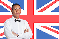 Portrait of mixed race man against British flag