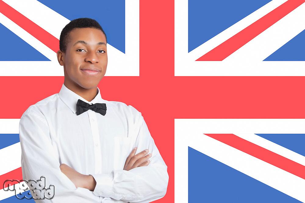 Portrait of mixed race man against British flag