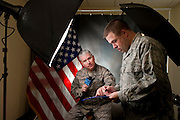 U.S. Air Force public affairs officers prepare for military news broadcast...A public affairs officers sit in front of the U.S. flag in preparation for his weekly news broadcast. They are in charge of escorting civilian media on base as well as write and broadcast Air Force news stories on base..