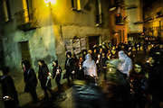 The religious procession in the streets of Verbicaro. Verbicaro, Italy. April 18th, 2014. Federico Scoppa