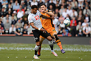 Derby County defender Cyrus Christie and Hull City midfielder Robert Snodgrass tussle for the ball during the Sky Bet Championship play-off first leg match between Derby County and Hull City at the iPro Stadium, Derby, England on 14 May 2016. Photo by Alan Franklin.