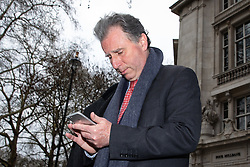 © Licensed to London News Pictures. 27/03/2019. London, UK. Sir Oliver Letwin MP leaves after appearing on a radio interview in Westminster this morning. Later today MPs are expected to vote on a series of indicative votes on alternative proposals to British Prime Minister Theresa May's withdrawal agreement. Photo credit : Tom Nicholson/LNP