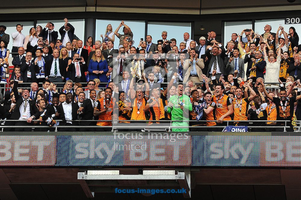 Hull City players lift the trophy after winning promotion during the Sky Bet Championship Play-off Final between Hull City and Sheffield Wednesday at KC Stadium, Hull<br /> Picture by Richard Blaxall/Focus Images Ltd +44 7853 364624<br /> 28/05/2016