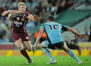 May 25th 2011: Ben Hannant of the Maroons attempts to fend of Kade Snowden of the Blues during game 1 of the 2011 State of Origin series at Suncorp Stadium in Brisbane, Australia on May 25, 2011. Photo by Matt Roberts/mattrIMAGES.com.au / QRL