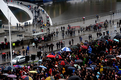 © Licensed to London News Pictures. 05/06/2017. Newcastle Upon Tyne, UK. A crowd of all ages lines the Quayside in Newcastle as they listen to Jeremy Corbyn MP, Leader of the Labour Party, as he addresses hundreds of his supporters who waited in the rain to hear him speak outside the Sage in Gateshead. Mr Corbyn spent one of the final days of the campaign trail in the Labour heartlands of North-East England before voters go to the polls in the UK General Election on June 8th 2017. Photo credit: MARY TURNER/LNP