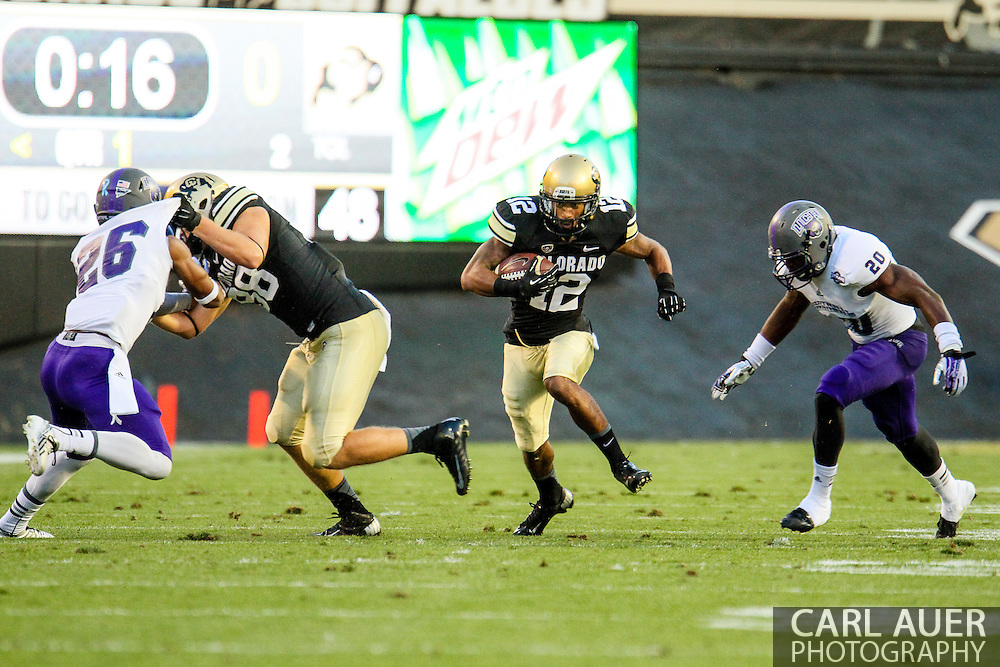 September 7th, 2013 - Colorado Buffaloes junior wide receiver Keenan Canty (12) attempts to run the ball up field in the first quarter of the NCAA football game between the University of Central Arkansas Bears and the University of Colorado Buffaloes at Folsom Field in Boulder, CO