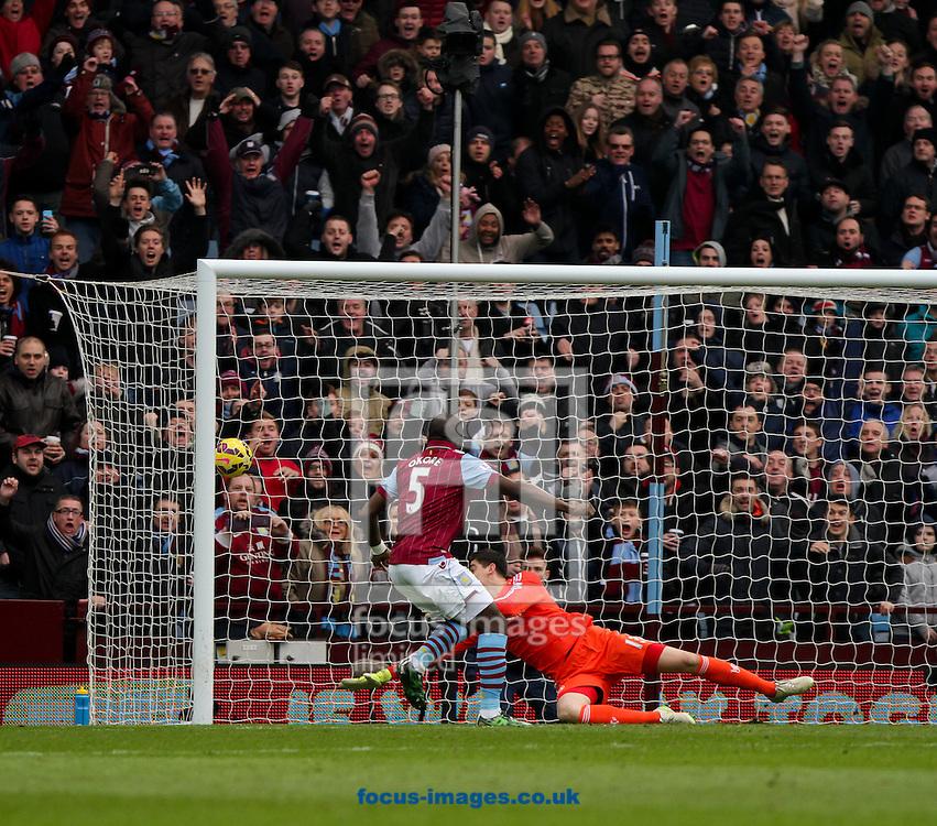 Jores Okore (left) of Aston Villa scores his sides first goal during the Barclays Premier League match at Villa Park, Birmingham<br /> Picture by Tom Smith/Focus Images Ltd 07545141164<br /> 07/02/2015