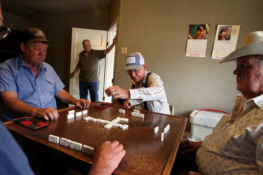 Left to right, Clark Weber, M.L. Compton (in doorway), Joe Holmes and Joel Weber play dominoes at the Masonic Lodge in Crawford Thursday May 1, 2008.  (Other domino player whose hand is visible is Bobby Harris.)