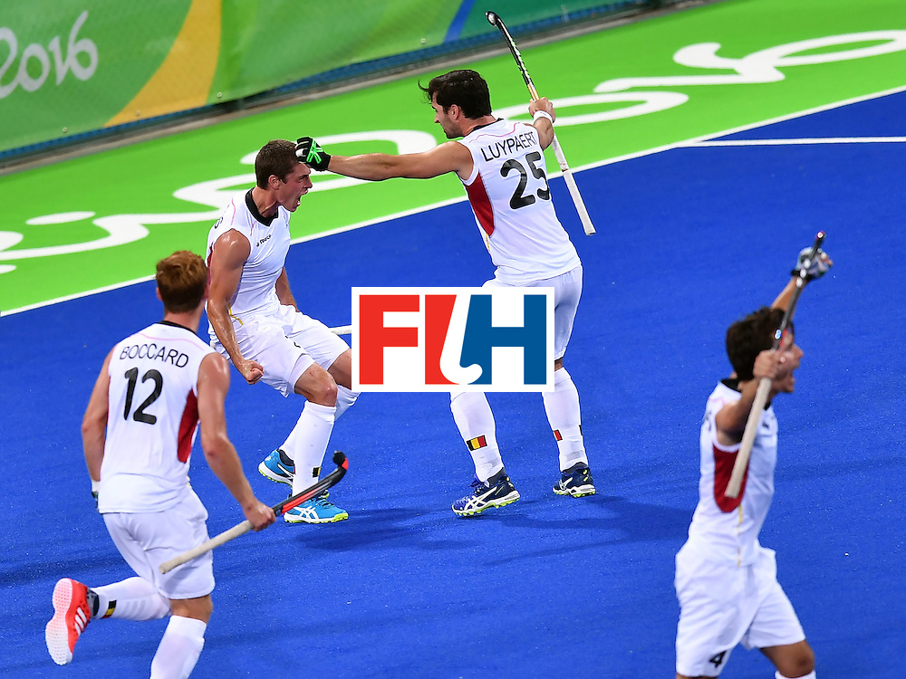 Belgium's Jerome Truyens (2nd L) celebrates a goal with teammates during the men's semifinal field hockey Belgium vs Netherlands match of the Rio 2016 Olympics Games at the Olympic Hockey Centre in Rio de Janeiro on August 16, 2016.  / AFP / MANAN VATSYAYANA        (Photo credit should read MANAN VATSYAYANA/AFP/Getty Images)