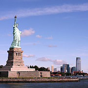 Statue of Liberty with Ellis Island and Jersey City Skyline in background