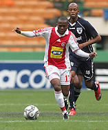 THULANI SERERO moves up field while Thando Mngomeni looks on during the PSL match between Ajax Cape Town and Bidvest Wits held at Newlands Stadium in Cape Town on 13 September2009 ..Photo by Shaun Roy/www.sportzpics.net.+27 21 785 6814..